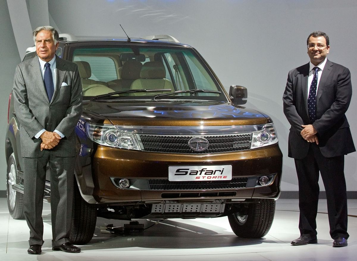 Ratan Tata, then chairman of Tata Motors Ltd., left, and Cyrus P. Mistry, then deputy chairman of Tata Sons Ltd., attend the launch of the Tata Safari Storm at the Auto Expo 2012 in New Delhi. (Photographer: Graham Crouch/Bloomberg)