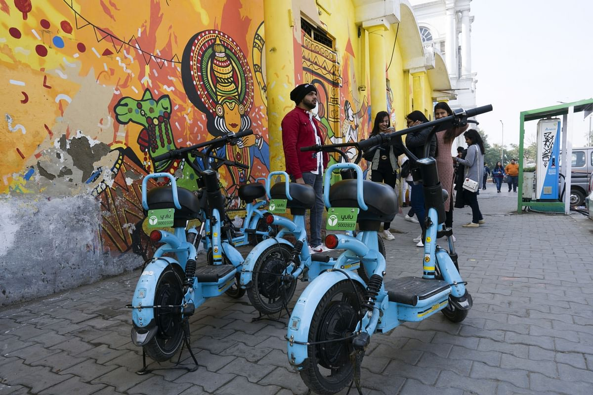 Yulu Bikes Pvt. ride-sharing bicycles stand parked at Connaught Place in New Delhi. Photographer: Ruhani Kaur/Bloomberg