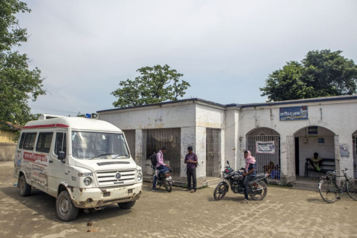 An ambulance stands outside the Primary Health Care Center in Raghopur, Bihar. (Photographer: Prashanth Vishwanathan/Bloomberg)