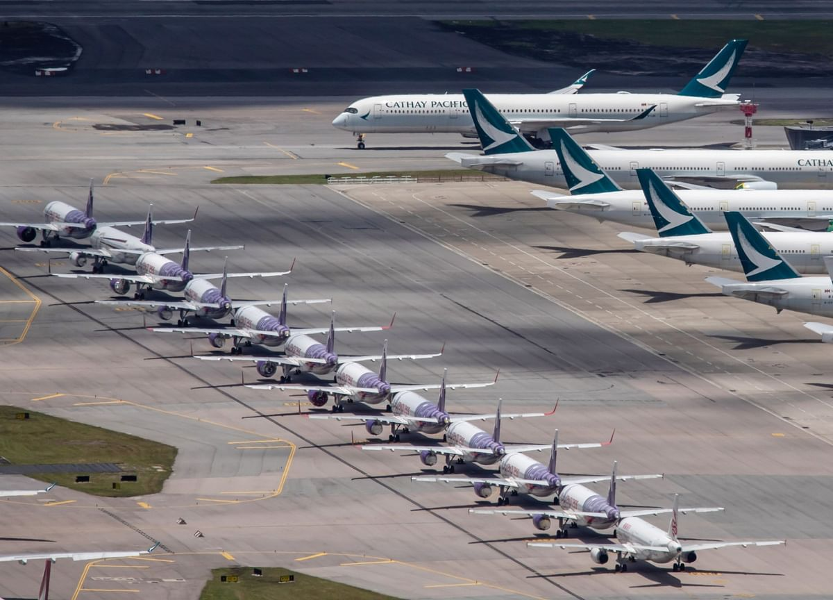 Cathay to Cut 6,000 Jobs and Close Dragon Brand, SCMP Says