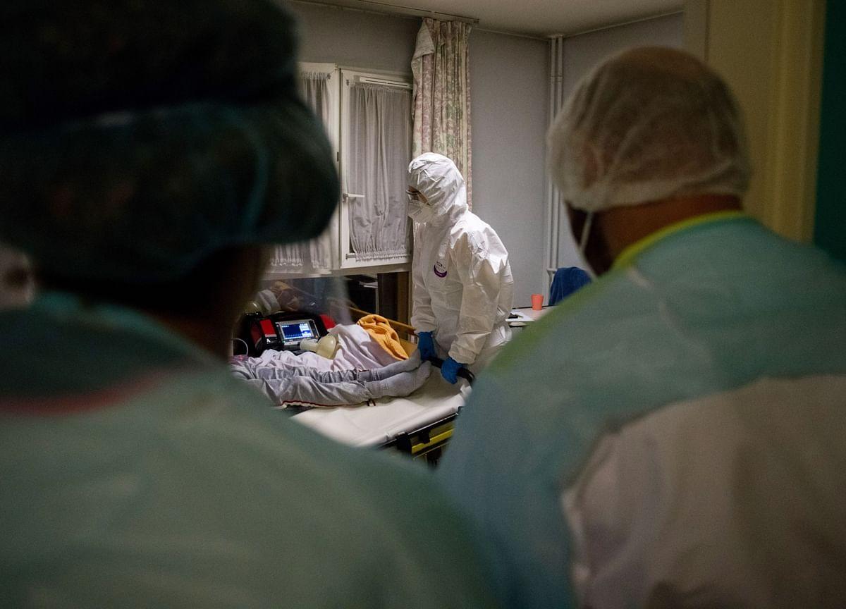 Chicago, Denver Tighten Limits; French Deaths Soar: Virus Update