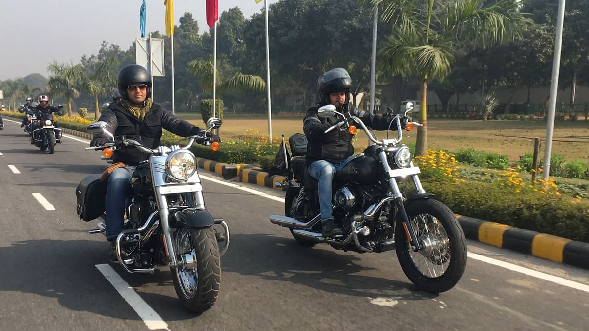 Members of Harley Davidson Owners Group riding a Fat Boy and Heritage Softail Classic in Delhi.