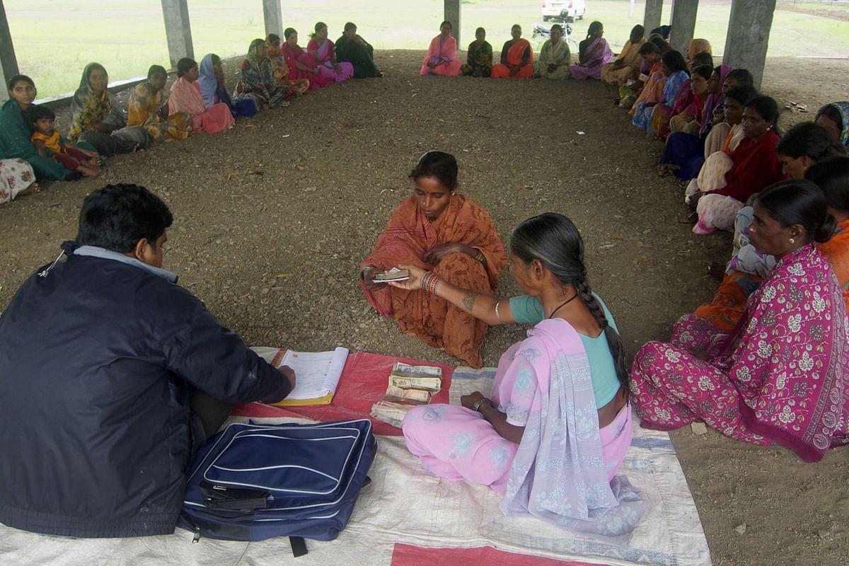 A woman receives a micro-loan in Sadashivpet, Telangana. (Photographer: Adeel Halim/Bloomberg)