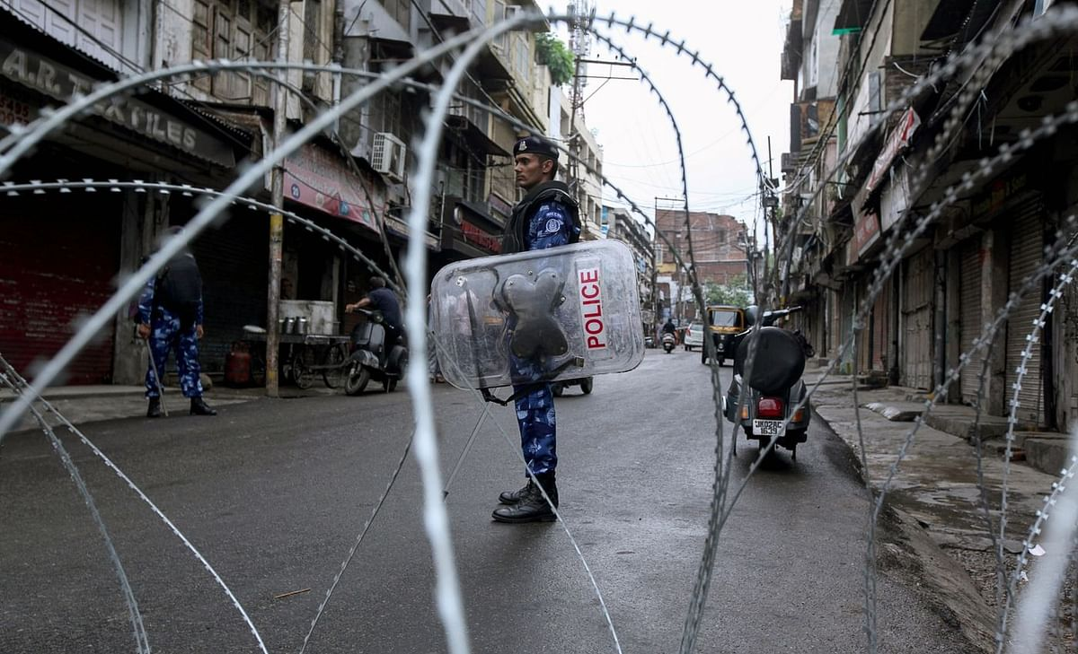 Rapid Action Force personnel stand guard at a roadblock ahead of the Muslim Friday noon prayers in Jammu, 2019. (Photo: Rakesh Bakshi/AFP via Getty Images)