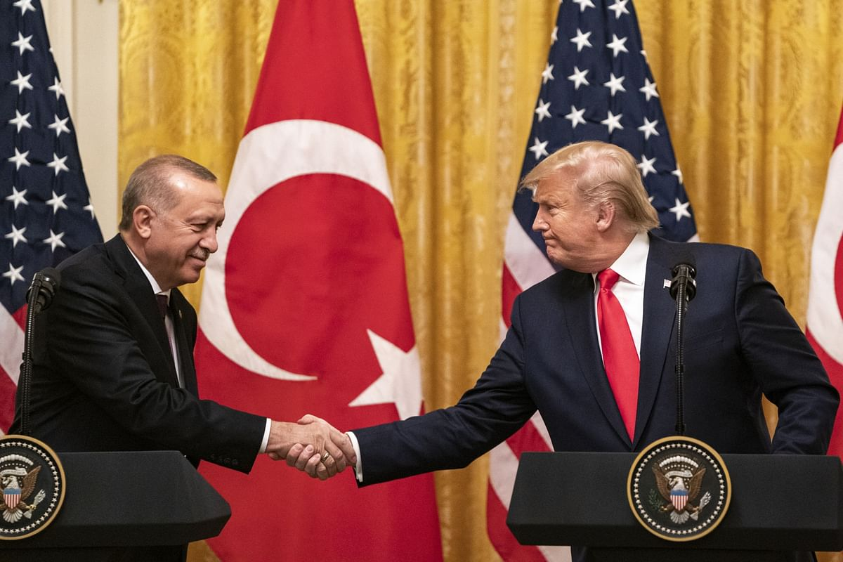 U.S. President Donald Trump shakes hands with his Turkish counterpart Recep Tayyip Erdogan at the White House in Washington, D.C., on Nov. 13, 2019. (Photographer: Alex Edelman/Bloomberg)