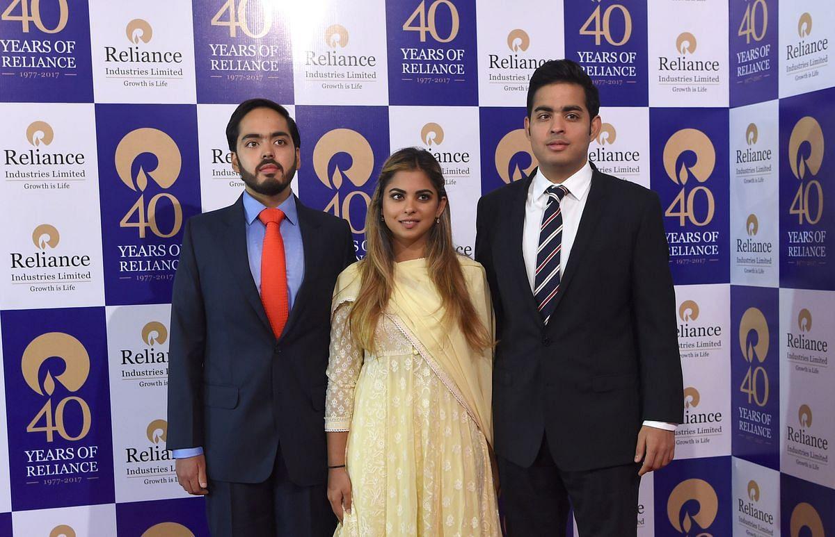 Anant, left, Isha, middle, and Akash Ambani. (Photographer: Sujit Jaiswal/ AFP)