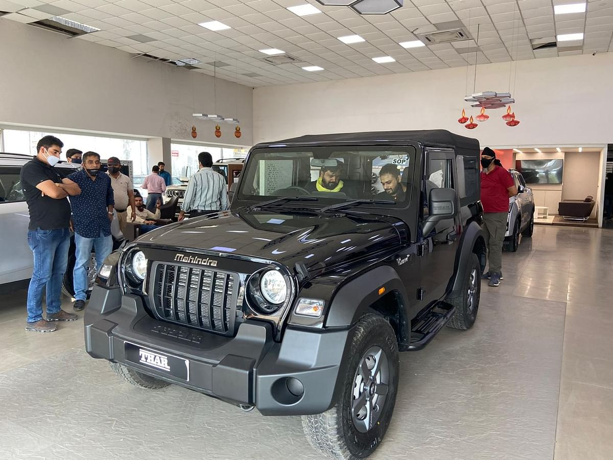 Consumers at a Mahindra dealership checking the newly launched That in Delhi-NCR. (Photographer: Nishant Sharma/BloombergQuint)