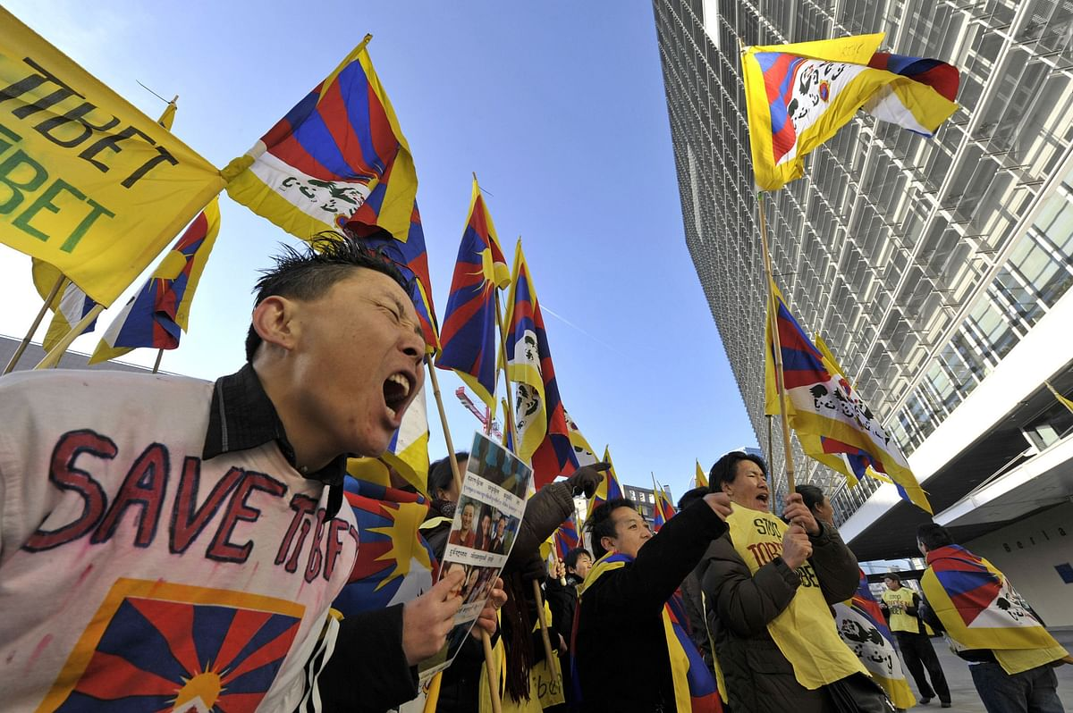 A group of demonstrators protest against China's Tibet policy outside the European Commission headquarters, in Brussels, Belgium. (Photographer: Jock Fistick/Bloomberg News)