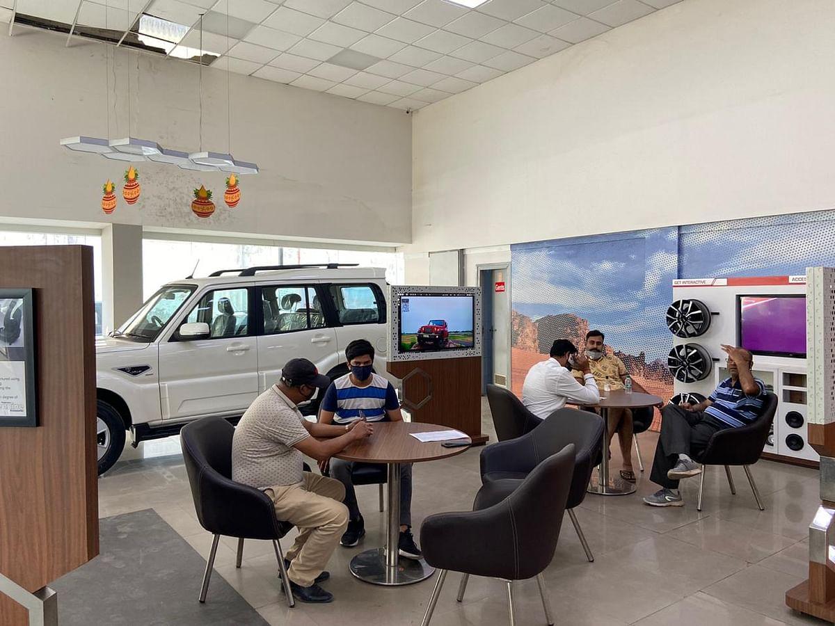 Consumers at a Mahindra dealership in Delhi-NCR. (Photographer: Nishant Sharma/BloombergQuint)
