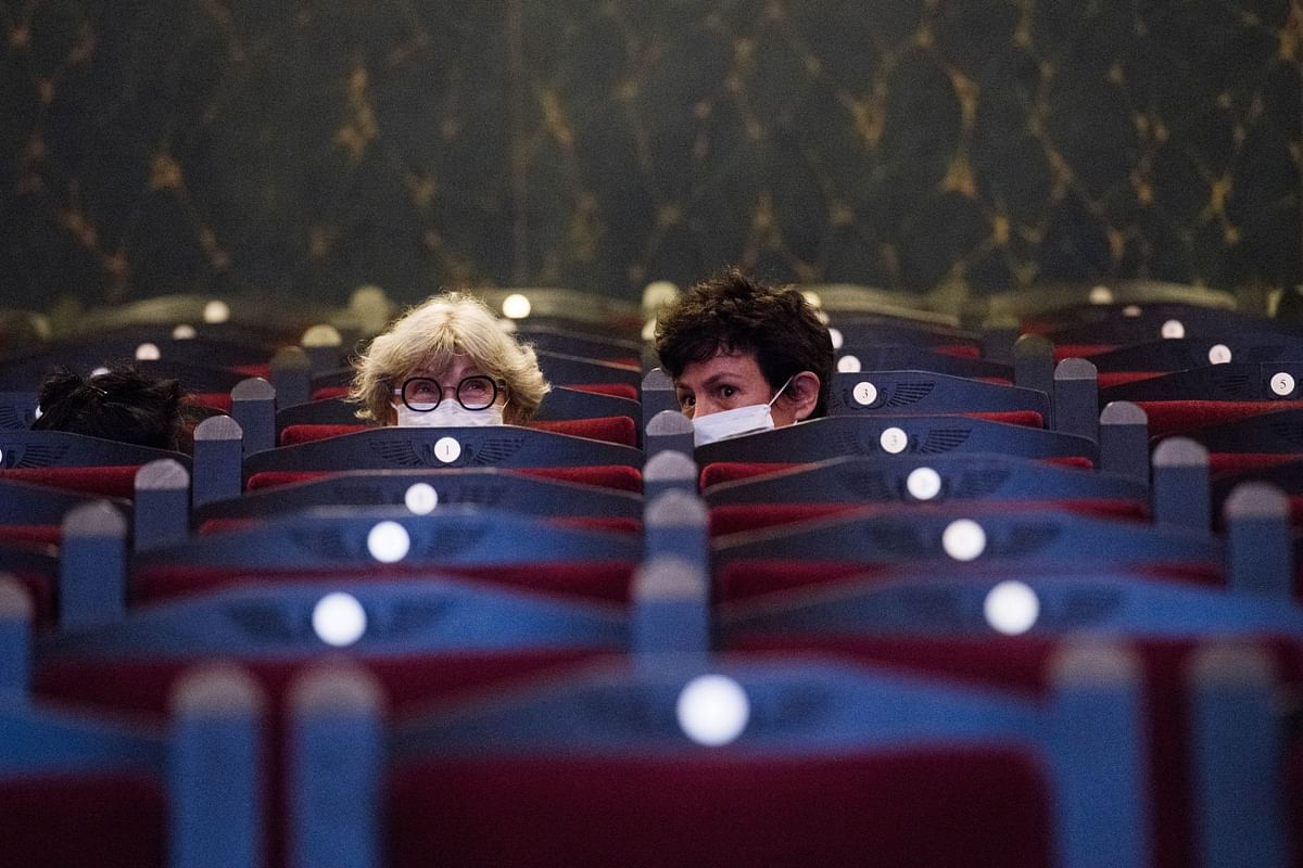 Two women at the Louxor cinema in Paris on June 22, the day it reopened. Photographer: Nathan Laine/Bloomberg