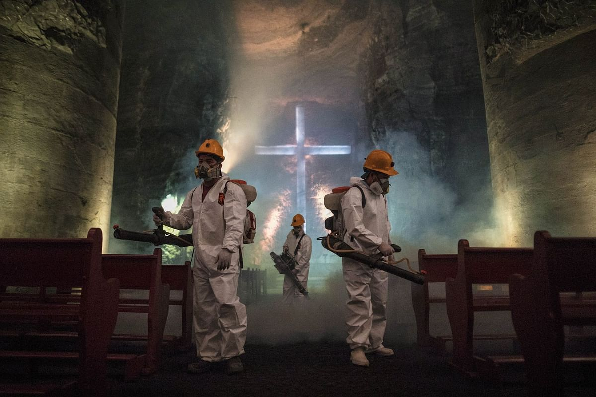 Workers disinfect the central nave of the Salt Cathedral in Zipaquira, Colombia, on April 8, during a nationwide lockdown. Photographer: Ivan Valencia/Bloomberg