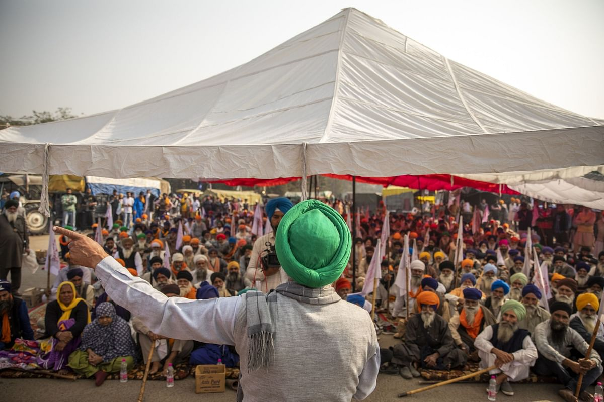 Farmers gather for a speech at a protest site at a road block on the Delhi-Haryana border crossing in Singhu, Delhi, India (Photographer: Prashanth Vishwanathan/Bloomberg)