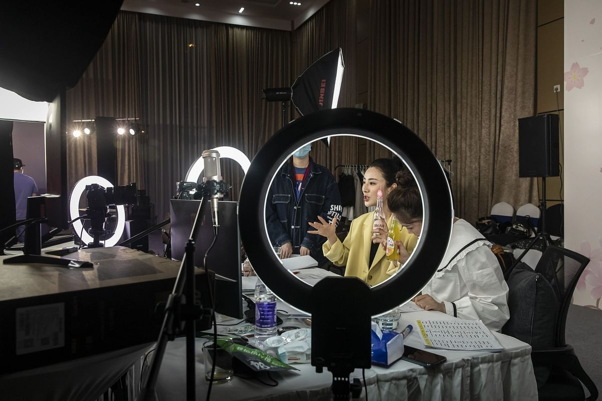 Livestreamer Huang Wei, known professionally as Viya, does a special event in Wuhan, China, on April 30. By the time Europe and the U.S. were being overwhelmed with infections, China was starting to emerge from its Covid-19 shutdowns. Photographer: Qilai Shen/Bloomberg