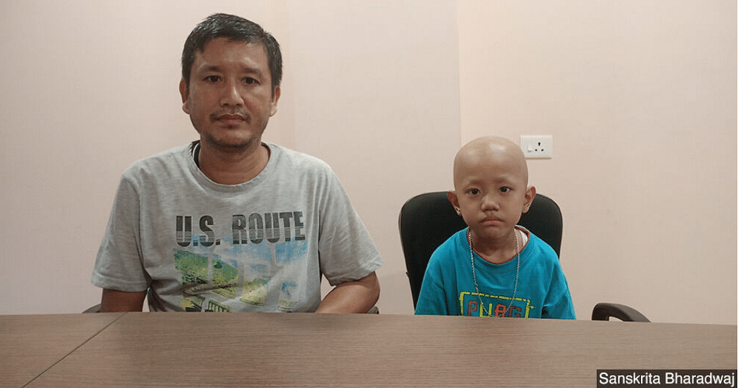 Lalchemla Singh with his son Kiran Singh. Kiran was diagnosed with small cell tumour. They travelled from Manipur to Assam for treatment.