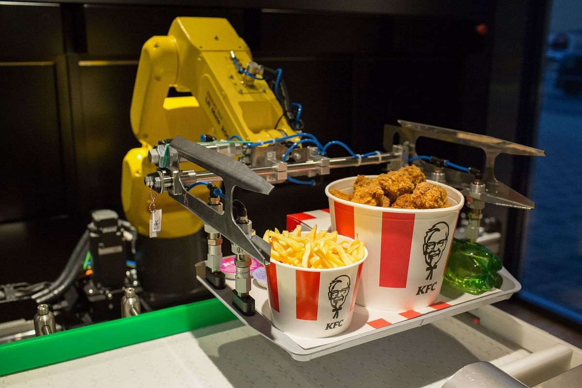 A robotic arm lifts an order from a conveyor at a contactless KFC restaurant ahead of its official opening in Moscow on June 12. Photographer: Andrey Rudakov/Bloomberg