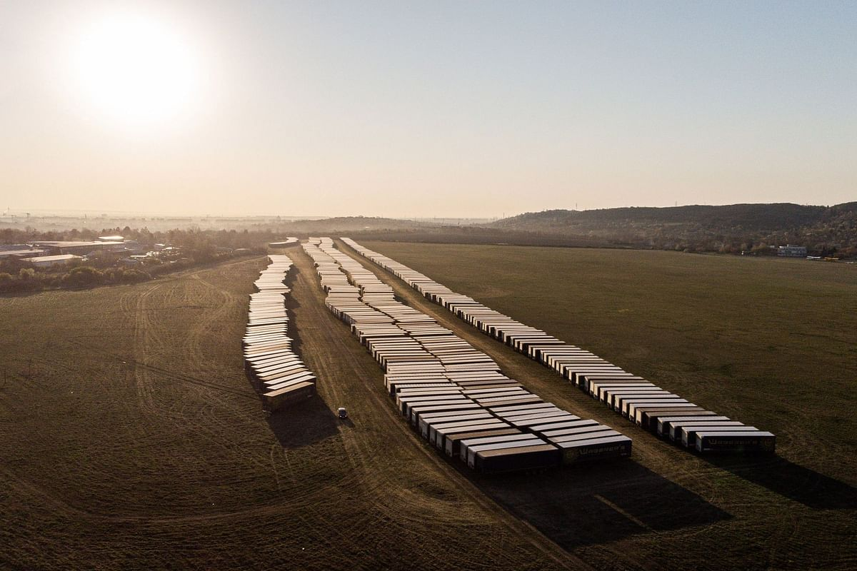 Unused truck trailers sit in an airfield near Budapest, Hungary, on April 8. Photographer: Akos Stiler/Bloomberg