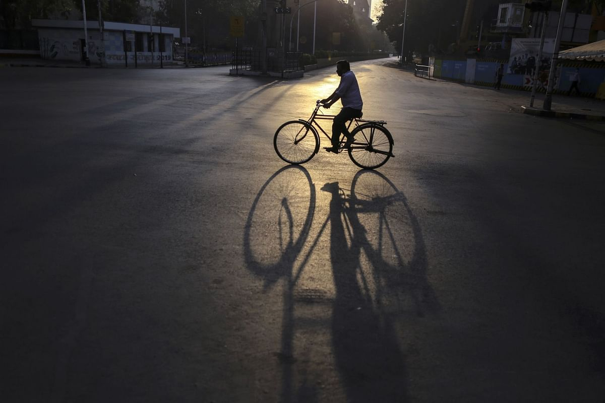 A cyclist rides through the Churchgate area during a lockdown in Mumbai, India, on April 5. Photographer: Dhiraj Singh/Bloomberg