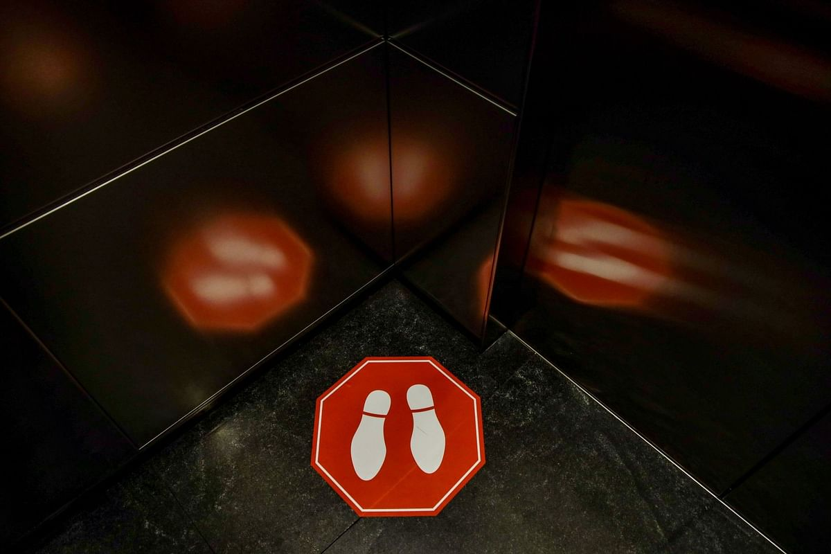 Social distancing markers allocate space in an elevator at the Unicredit SpA headquarters in Milan on June 8. Photographer: Francesca Volpi/Bloomberg