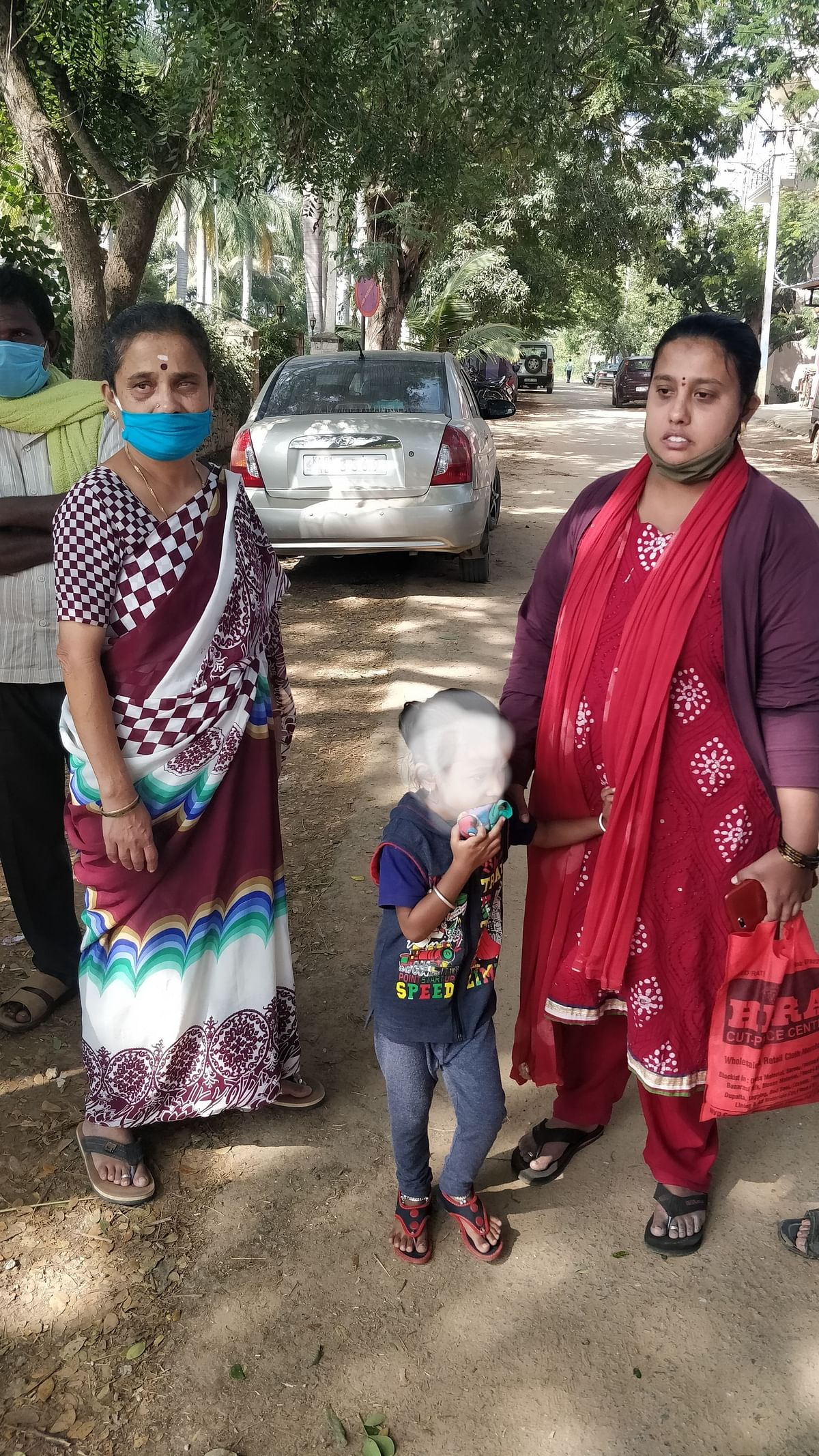 Sowmya with her mother and child outside the Kolar police office. (Source: Ashwini YS for BloombergQuint)