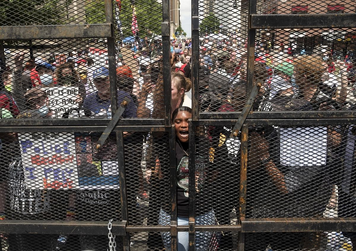 U.S. President Donald Trump was confronted by a national upheaval over American police killings of unarmed Black citizens. In Tulsa, Oklahoma, demonstrators rallied at an entrance gate to one of his campaign events on June 20. Photographer: Matthew Hatcher/Bloomberg