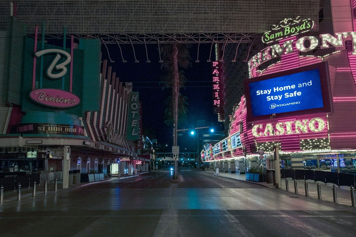 The bright lights of Las Vegas dimmed as the virus took hold. A few signs remain lit on April 15. Photographer: Bridget Bennett/Bloomberg