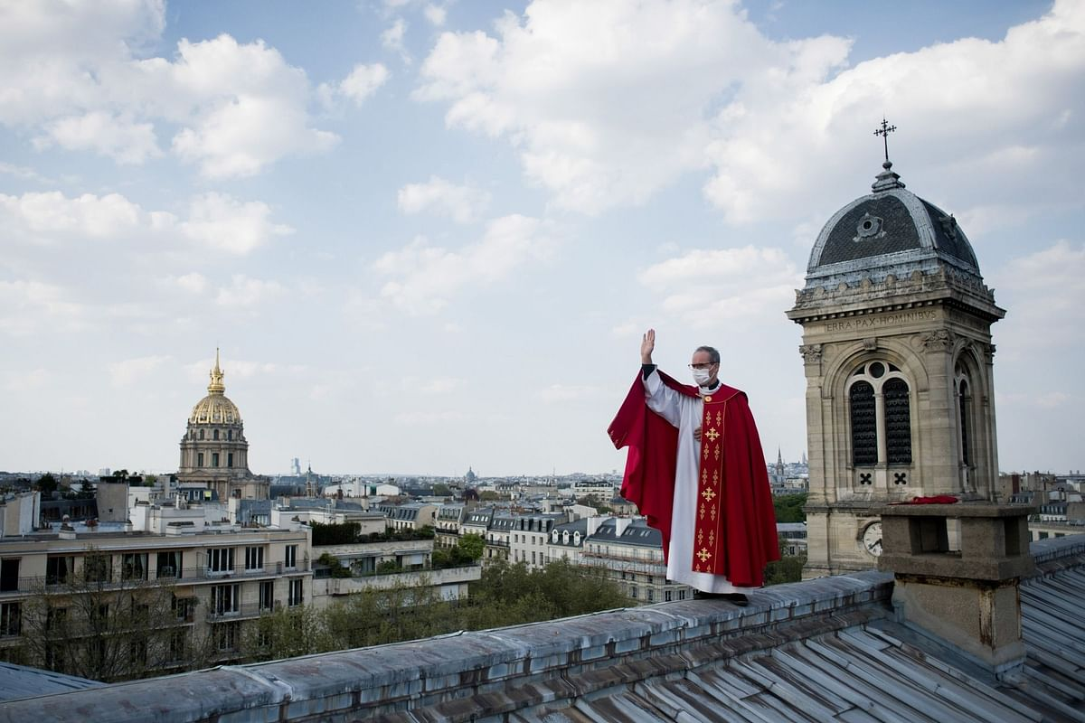 Father Bruno Lefevre Pontalis went to the roof of Saint Francois Xavier church to bless Paris during lockdown on April 11. Photographer: Nathan Laine/Bloomberg
