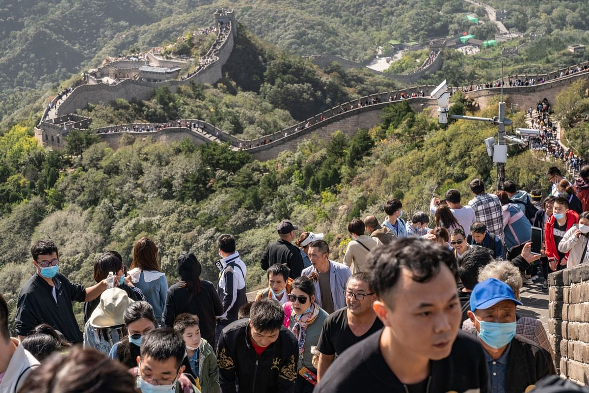 Visitors to the Badaling section of the Great Wall in Beijing on Oct. 1. China has had a head start in recovering from the pandemic after its successful initial lockdown strategy. Photographer: Yan Cong/Bloomberg