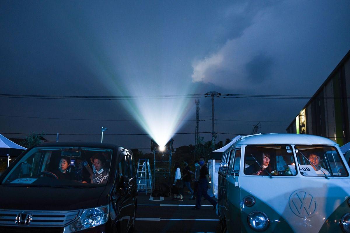 In Inzai, Japan, drive-in moviegoers enjoyed a similar diversion on Aug. 22. Photographer: Noriko Hayashi/Bloomberg