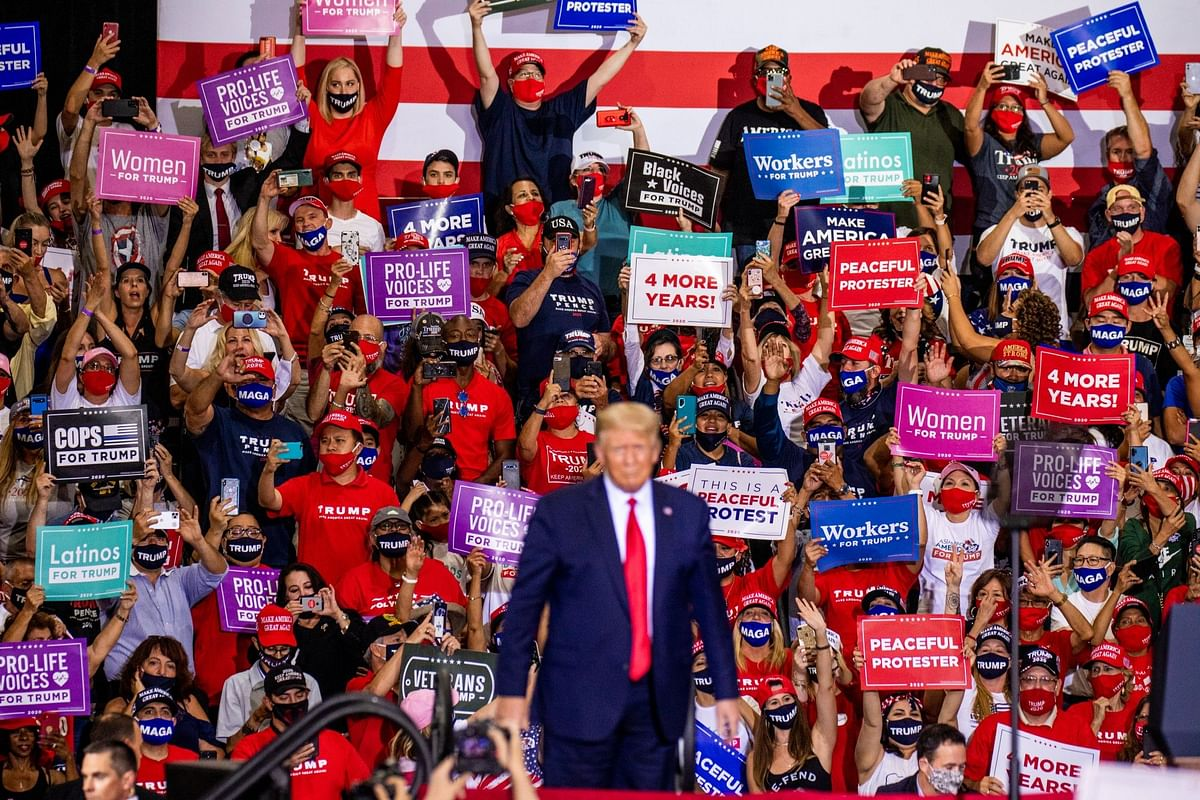 A Trump campaign rally at a warehouse in Henderson, Nevada, on Sept. 13 was held in defiance of state law barring large gatherings. More than 2,500 Nevada residents have died from Covid-19. Photographer: Roger Kisby/Bloomberg