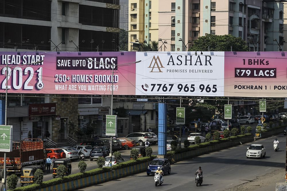 An advertisment for real estate develop Ashar Group in Thane on the outskirts of Mumbai. (Photographer: Dhiraj Singh/Bloomberg)