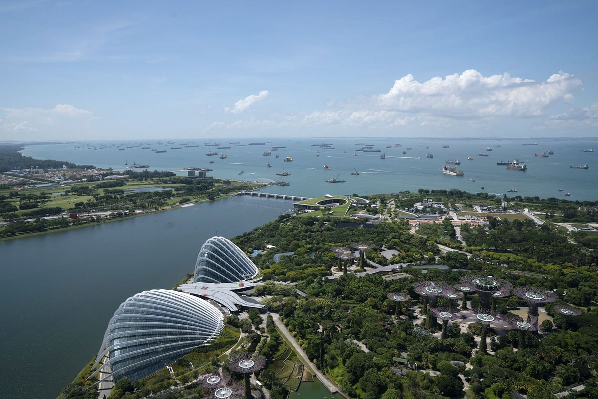 Ships are moored off the coast of Singapore on July 6. The pandemic slowed global trade while stranding seafarers caught up in port and border restrictions aimed at reducing the spread of Covid-19. Photographer: Wei Leng Tay/Bloomberg