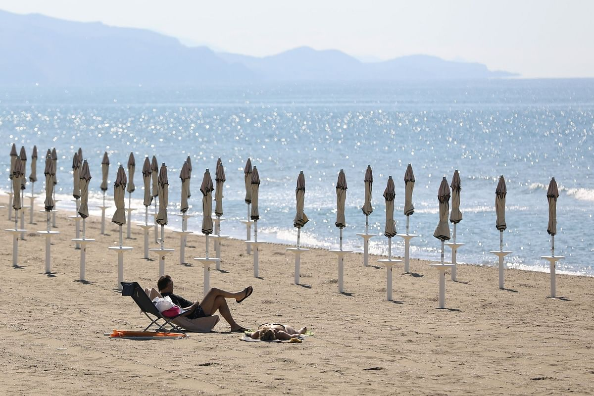 A beach in Terracina, Italy, just south or Rome, is nearly empty on May 31. Tourism across Europe was decimated by the pandemic. Photographer: Alessia Pierdomenico/Bloomberg