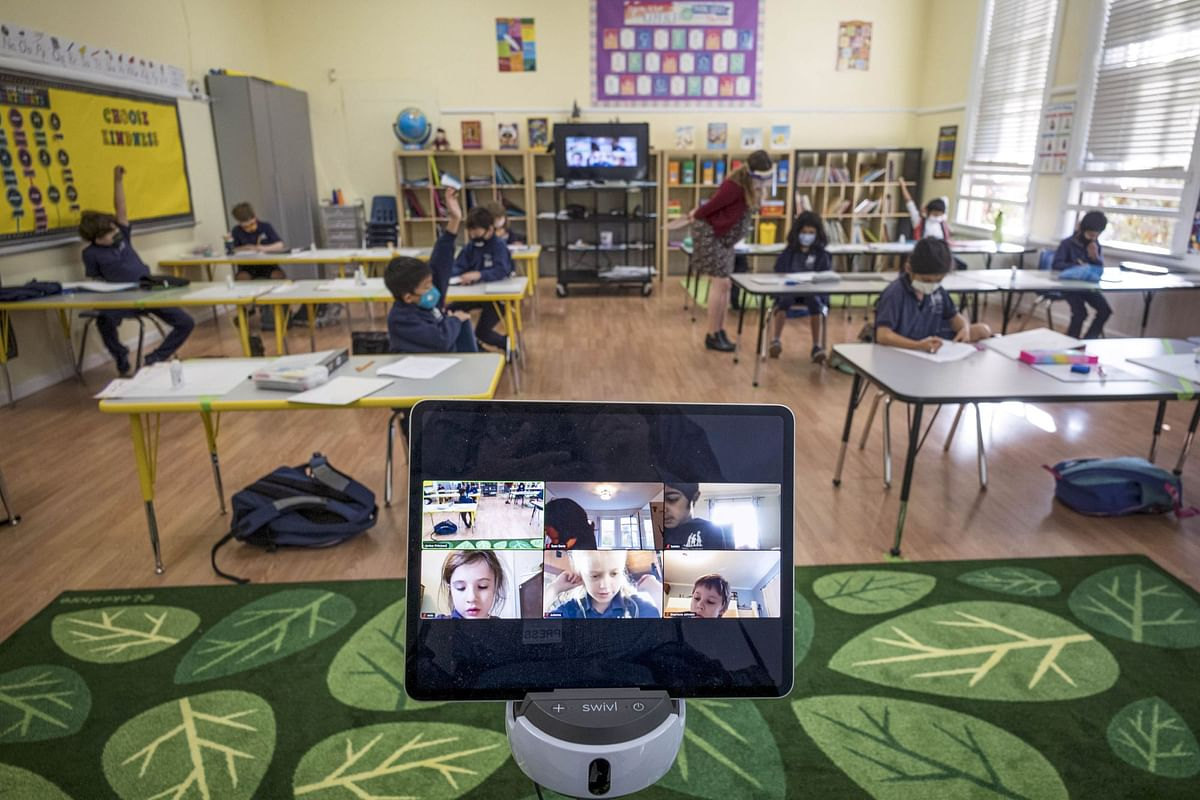 Students attend school in San Francisco on Oct. 5. Many systems combined in-person and remote learning as infection rates rose and fell. Photographer: David Paul Morris/Bloomberg