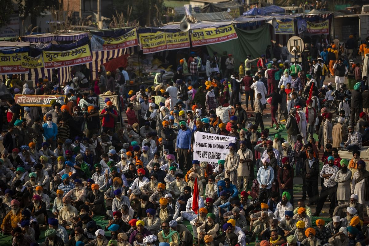 Farmers gather for a speech at a protest site at a road block on the Delhi-Haryana border crossing in Singhu, Delhi, India. (Photographer: Prashanth Vishwanathan/Bloomberg)