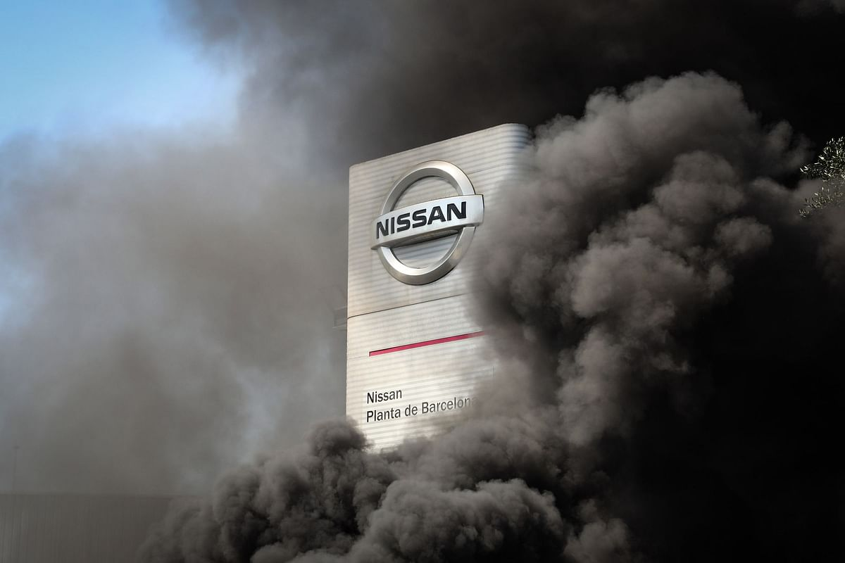 Demonstrators set tires on fire on May 28 outside a Nissan Motor Co. plant slated for closure in Barcelona. Photographer: Angel Garcia/Bloomberg