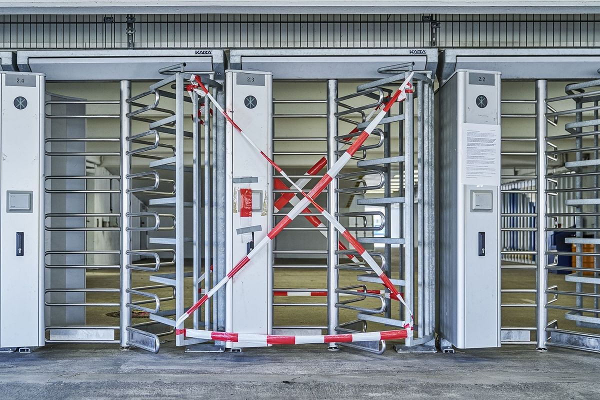 A staff entrance is closed at the Ford Motor Co. factory in Cologne on March 24, after the automaker halted its German assembly operations. Photographer: Wolfram Schroll/Bloomberg