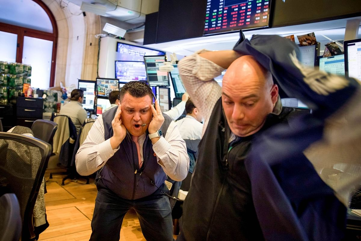 Traders on the floor of the New York Stock Exchange on March 12. Despite a selloff when shutdowns began, the subsequent U.S. recession and unprecedented unemployment didn't stop Wall Street from hitting new records. Photographer: Michael Nagle/Bloomberg