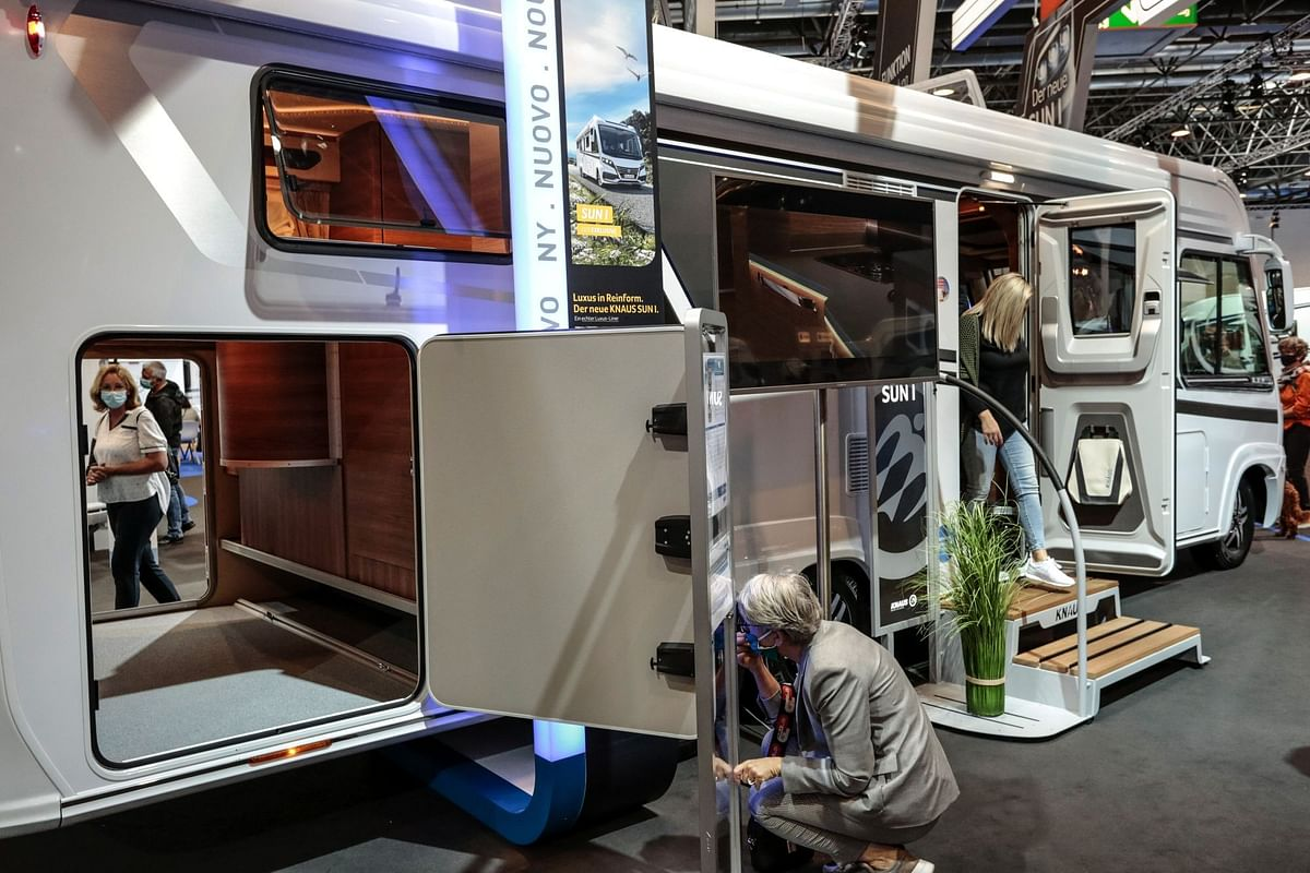 Attendees at the Caravan Salon expo in Düsseldorf, Germany, inspect a luxury motor home on Sept. 8. Recreational vehicles saw a significant uptick in sales this year as people sought to get away while staying far from crowds. Photographer: Sarah Pabst/Bloomberg