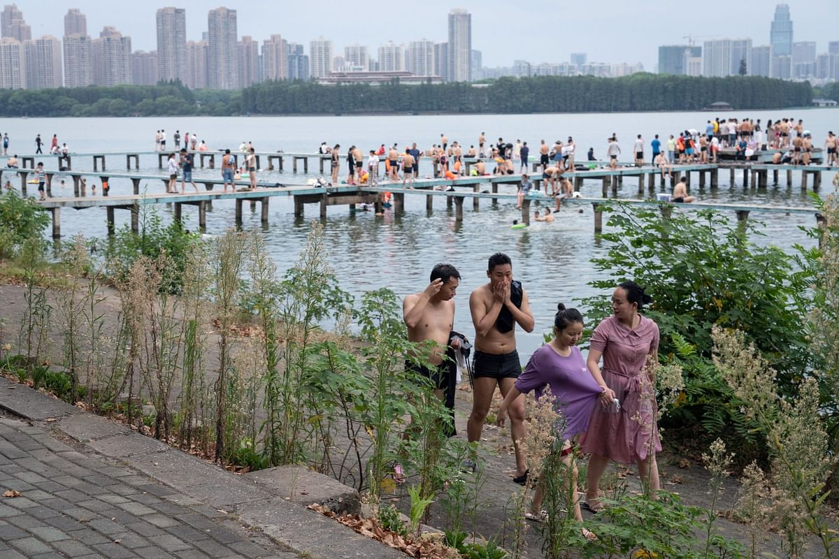 More than eight months after the novel coronavirus emerged in Wuhan, the Chinese city was moving into a post-virus future. This is Donghu Lake on Aug. 8. Photographer: Yan Cong/Bloomberg