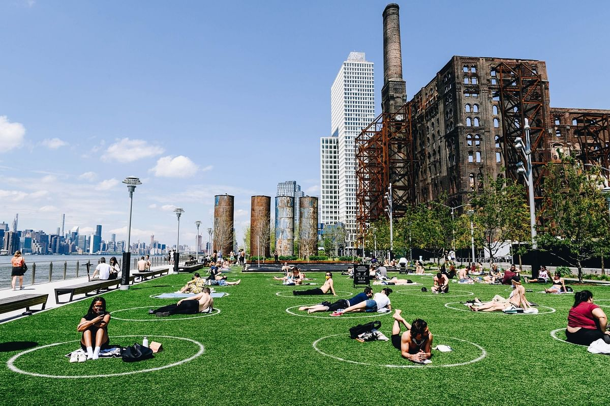 People sit in distancing circles at Domino Park in Brooklyn, New York, on May 15. Photographer: Nina Westervelt/Bloomberg