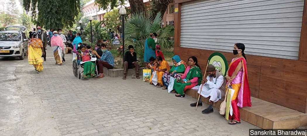 Patients and their families wait outside the Dr Bhubaneswar Borooah Cancer Institute in Guwahati, Assam, one of the oldest cancer care centres in the Northeast.