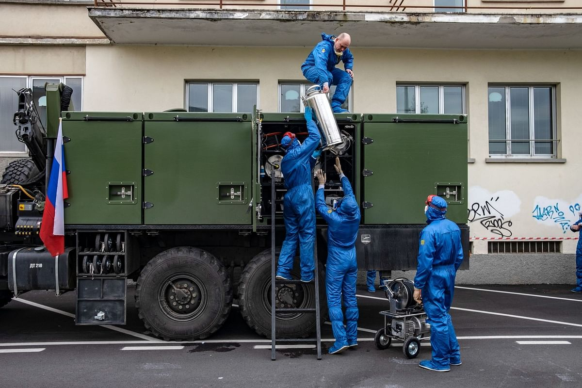 In Bergamo, Italy, Russian soldiers pack disinfection equipment at a nursing home on April 1. Italy received help from President Vladimir Putin as infections climbed in the spring. Photographer: Francesca Volpi/Bloomberg