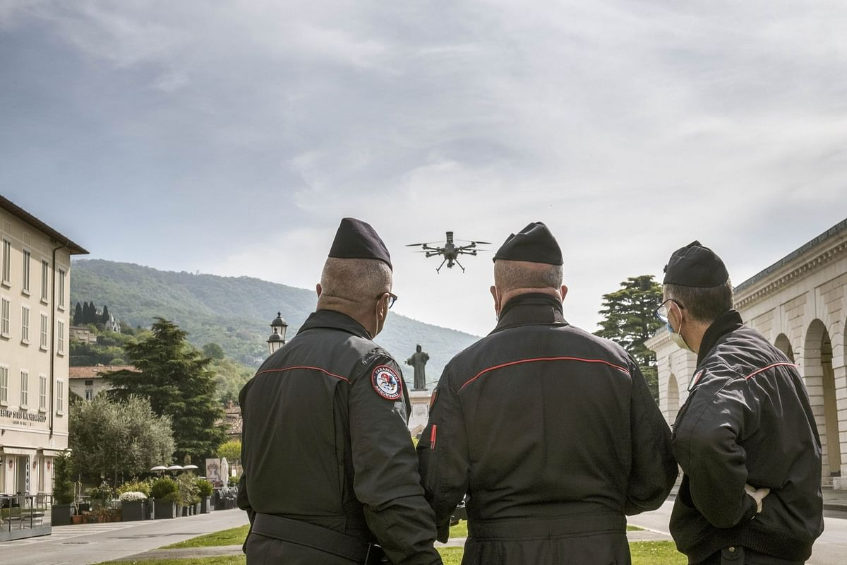 Italian officers launch a drone to monitor the lockdown in the city of Brescia on April 18. Photographer: Gianmarco Maraviglia/Bloomberg