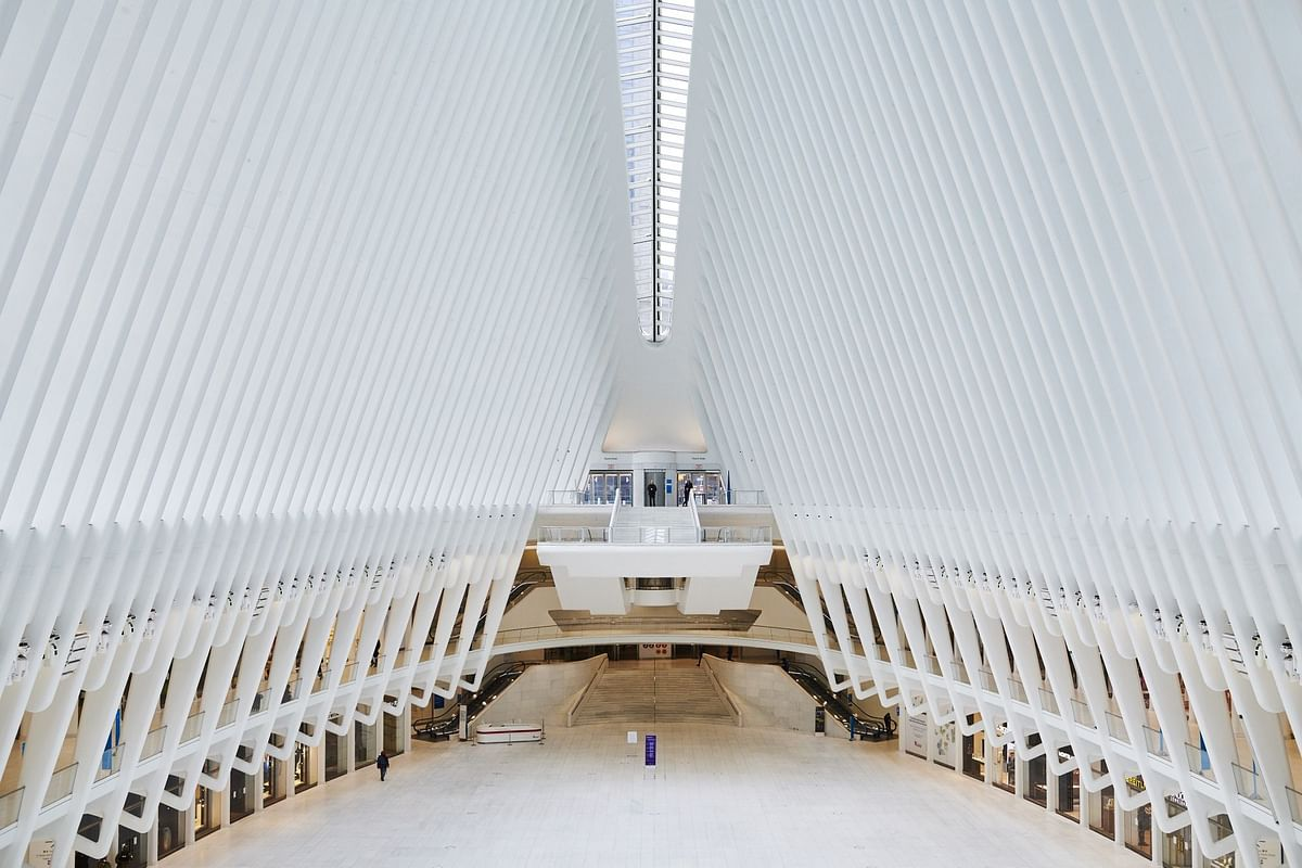 A pedestrian walks through the almost empty Oculus transportation hub in New York City, next to the World Trade Center, on March 30. Photographer: Gabby Jones/Bloomberg