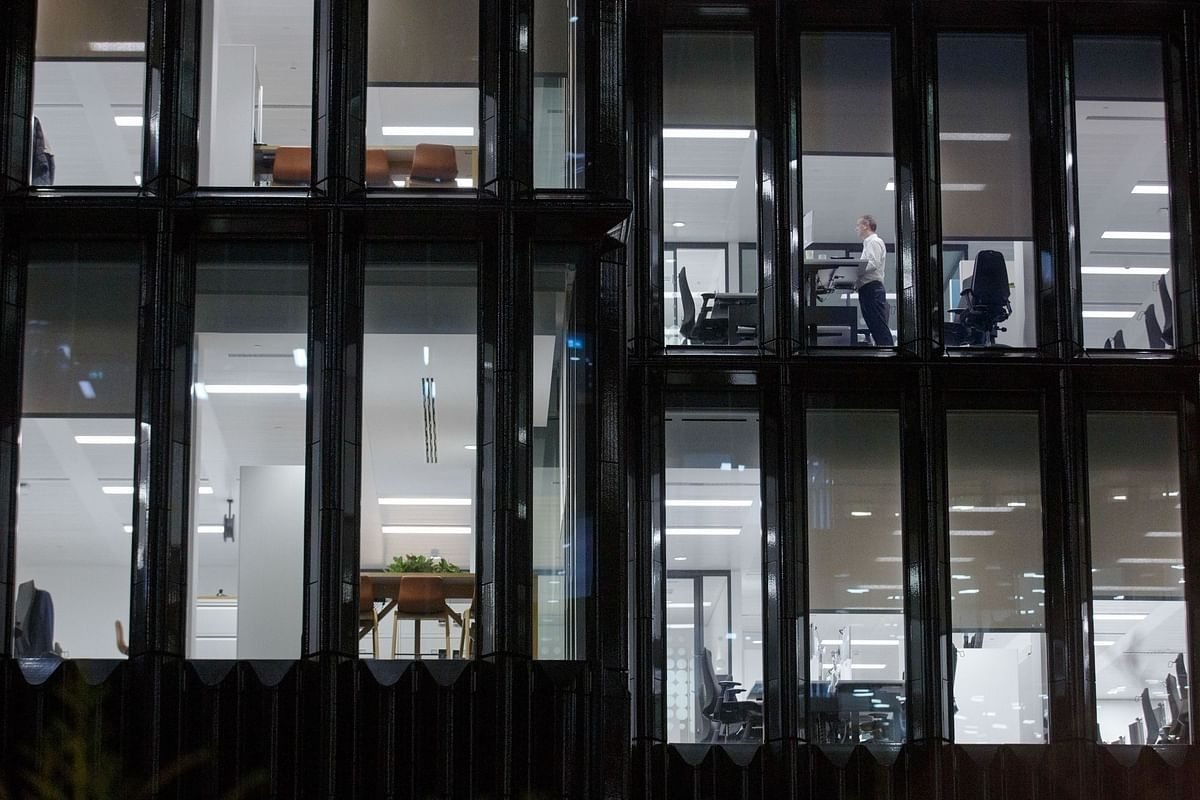 As financial-services companies sent employees to work from home, a lone office worker in London remained at his post on March 16. Photographer: Luke MacGregor/Bloomberg