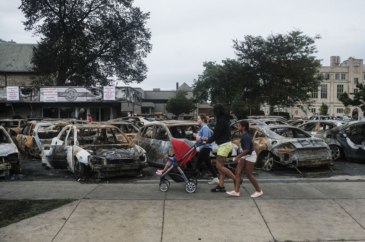A burned out auto dealership in Kenosha, Wisconsin, on Sept. 1, a week after a White police officer, Rusten Sheskey, shot Jacob Blake, an unarmed Black man, several times in the back, paralyzing him. Photographer: Matthew Hatcher/Bloomberg