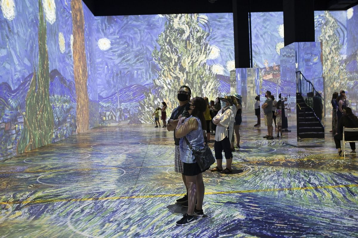 Visitors at the Immersive Van Gogh Exhibit in Toronto, Canada, on July 3. Photographer: Stephanie Foden/Bloomberg