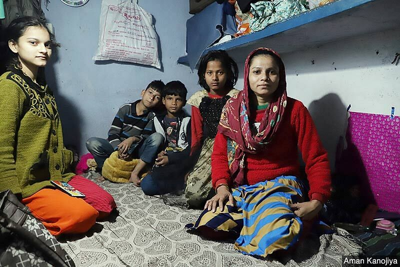 Mehar-un-Nissa sitting with her and a neighbour's children in her home in Delhi's Okhla. She moved to the capital from Bihar's Motihari district few years ago in hope of a better life for her family. She found work in a garment factory and barely manages to scrape through the month.