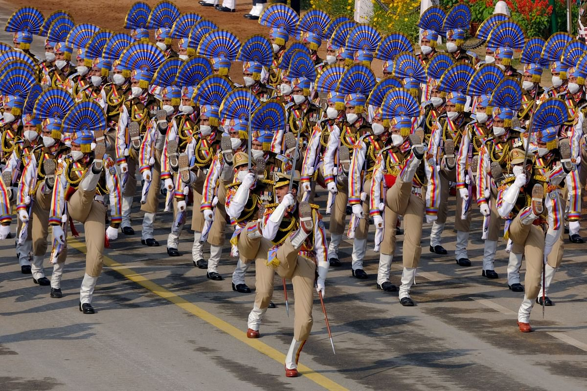 Indian Army soldiers march through the ceremonial Rajpath during the Republic Day parade in New Delhi (Photographer: T. Narayan/Bloomberg)