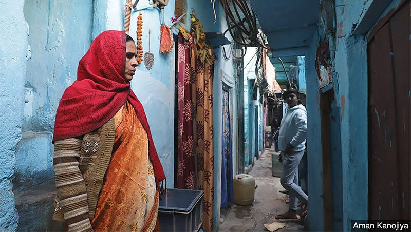 Durga Devi, who came from Bihar's Madhubani village 20 years ago, stands outside her home in Delhi's Okhla. She's among several women who face hurdles at every step of the way when it comes to work, whether being the first to lose jobs during the pandemic or putting in extra hours on household chores.